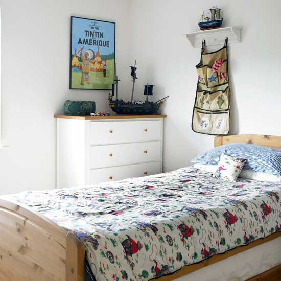 Boys' bedroom with white chest of drawers and hanging storage