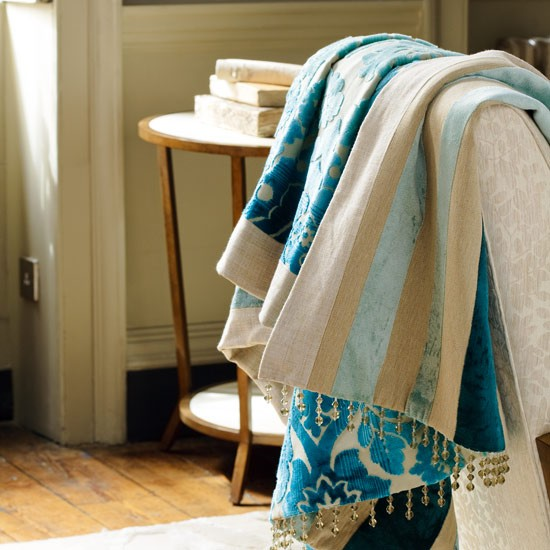 Mix pattern and stripes to make an elegant, reversible throw with a sparkling trim