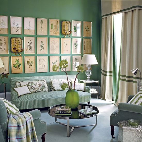 Pale accessories and soft furnishings break up the green colour palette in this living room