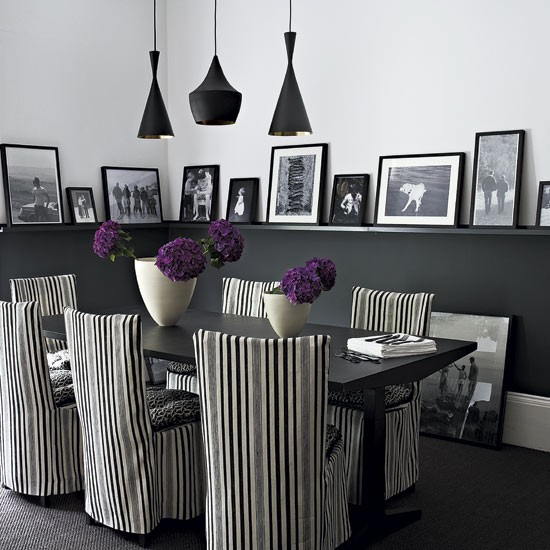 Make a feature out of your family photos to enjoy while entertaining in the dining room