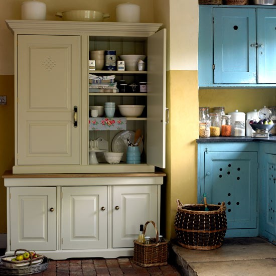 View into rustic kitchen from the pantry with colourful vintage