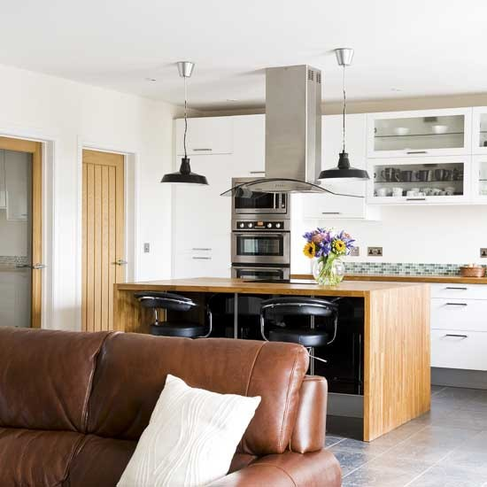 Open-plan kitchen | Leather sofa | Wooden island | Image | Housetohome