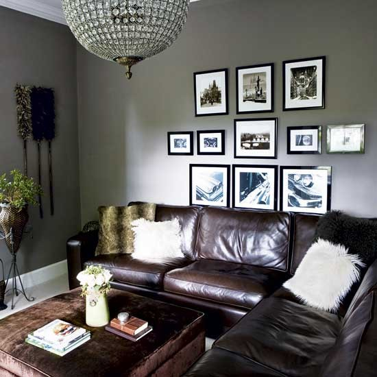 soft grey walls give this living room an elegant feel leather and