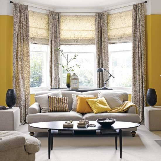 simple grey sofa set against sunny yellow walls creates a