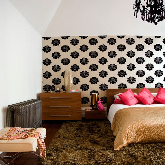 Bedroom with polka dot wallpaper and double bed