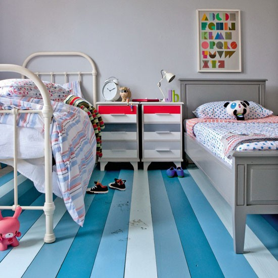 Boys' twin bedroom with striped flooboards and twin beds