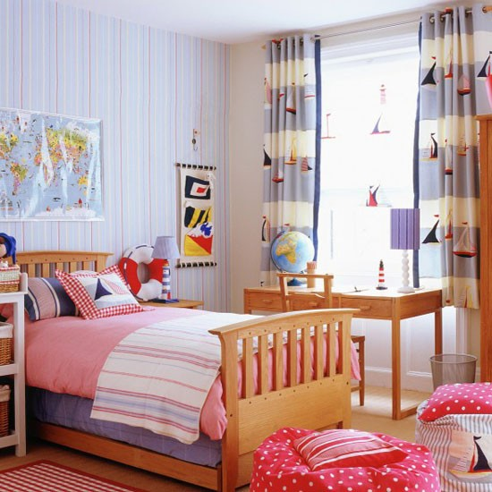 Boys' bedroom with blue striped wallpaper and boat-print curtains