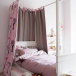 Girl'd bedroom with four-poster bed
