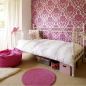 Chic girl's bedroom with feature wall and pink rug