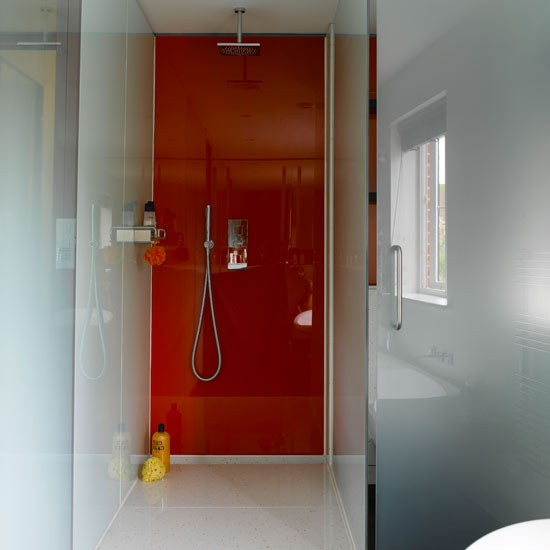 Create a sleek look with glass get designer bathroom for Glass panel walls