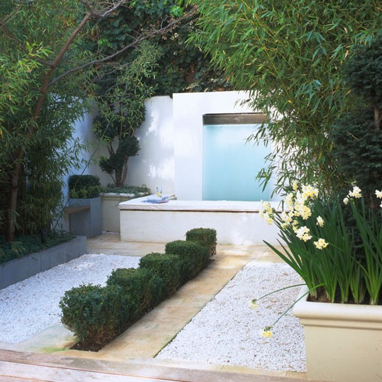 Contemporary garden with coloured gravel and stone pathways