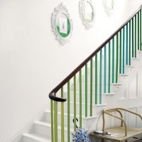 White hallway with colourful balustrade