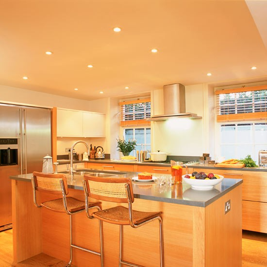 Modern basement kitchen with task lighting and wood floor wood and
