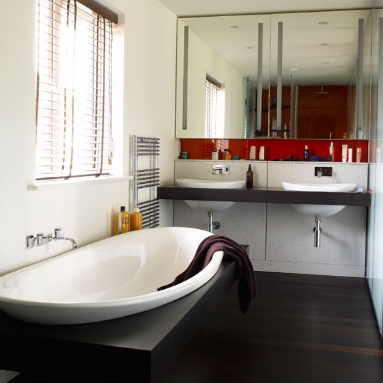 Modern bathroom pictures house to home for Monochromatic bathroom designs