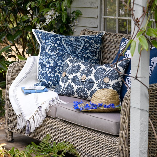 Our envelope cushion (centre) makes a great addition to an outdoor sofa bench