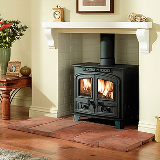 i think we 39 d be more drawn to the jotul than the tv in. Black Bedroom Furniture Sets. Home Design Ideas