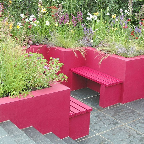 Garden with bright pink planters Color: In the Pink