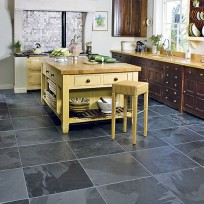 Slate floor tiles are sleek and complement most styles of kitchen units very well