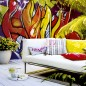 Garden patio with statement wall mural, white sofa and white decking