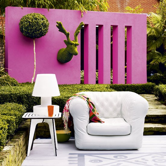 Colourful garden wall garden walls garden paint Garden wall color ideas
