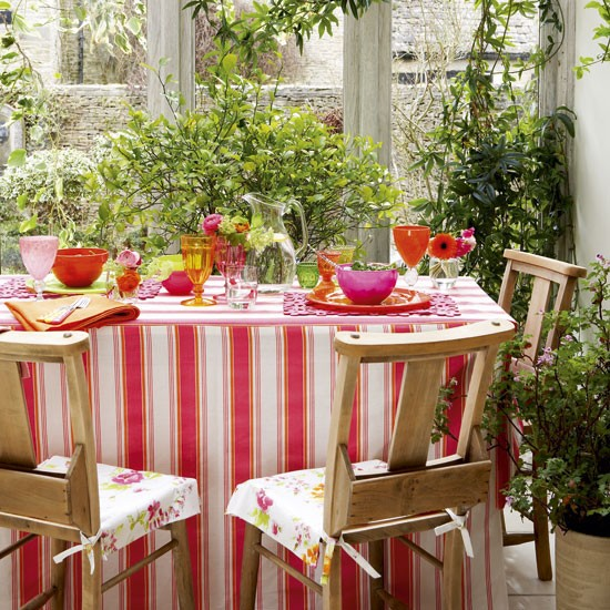 Colourful conservatory dining conservatory design ideas for Conservatory dining room decorating ideas