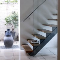 Modern hallway with white walls and stone floor tiles