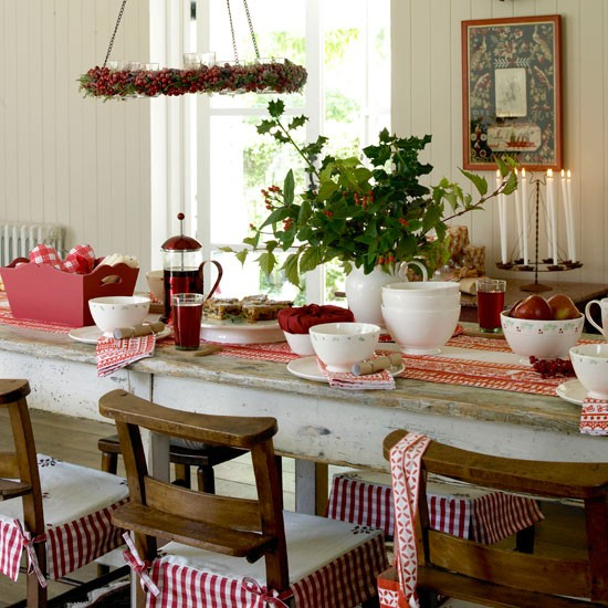 Make Christmas dinner extra special with red and white crockery and rustic decorations