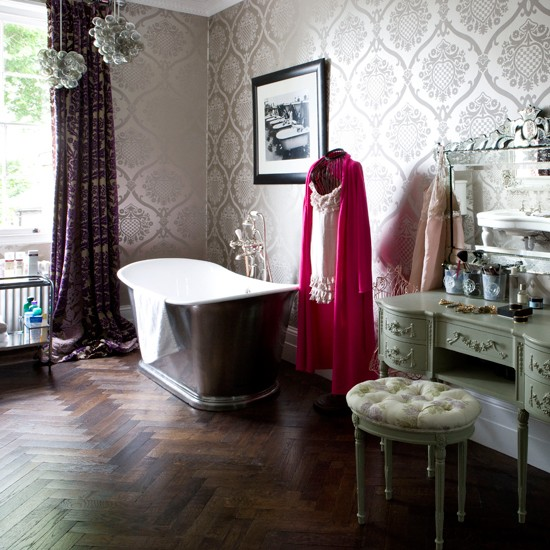 Vintage bathroom with flocked wallpaper and wooden floor