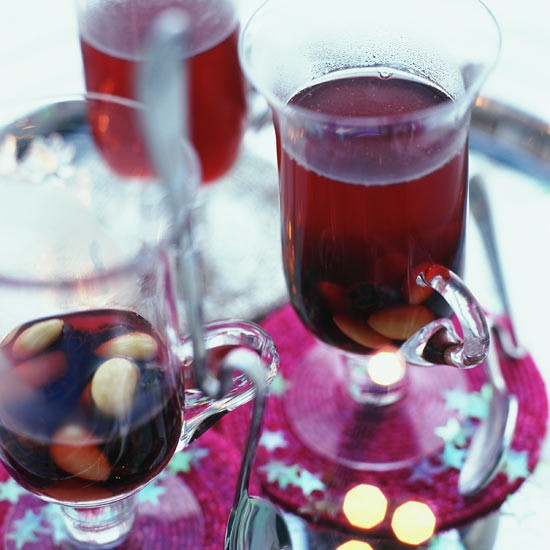 Serve New Year&#039;s guests mulled wine as they arrive 