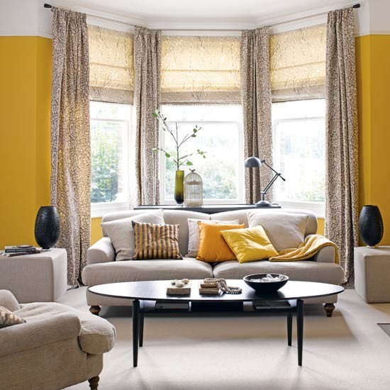 Zesty yellow living room with bay window | Traditional living room
