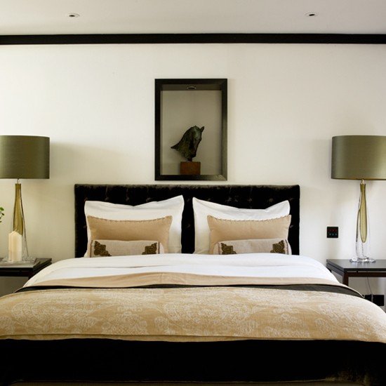 Classic master bedroom with bedside lamps and tables for Bedroom design uk