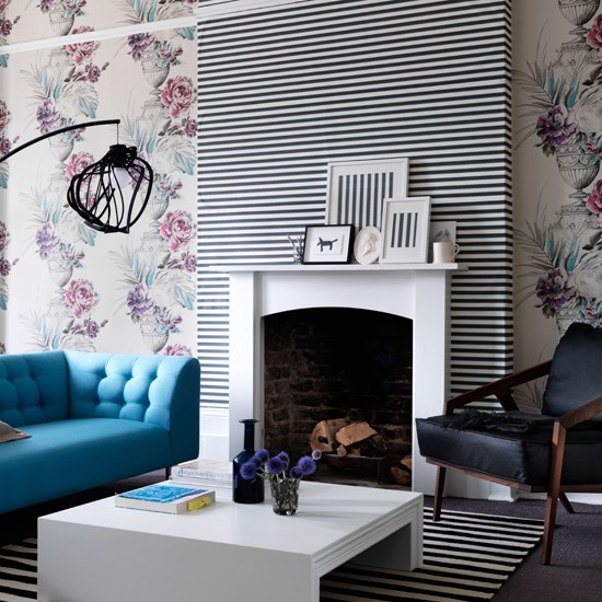 living room with floral living room wallpaper black and white striped