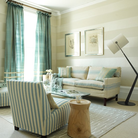 ... with striped living room wallpaper, striped sofas and teal curtains