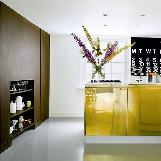 Modern kitchen with gold island unit | Kitchen units | Kitchen flooring | Image | Housetohome