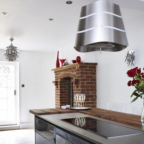 Modern Kitchen With Brick Fireplace Kitchen Island