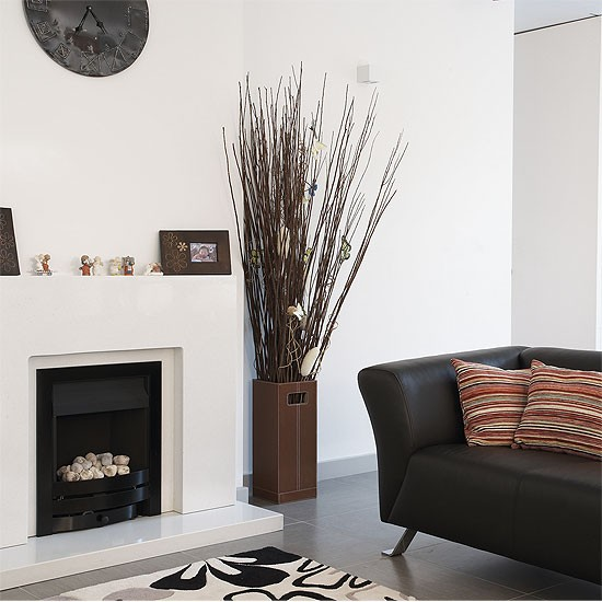 Monochrome living area with feature fire