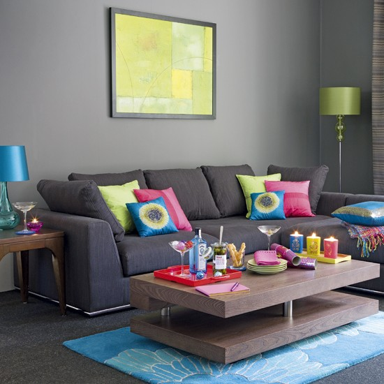 Grey living room grey sofas colourful cushions for Living room ideas pink and grey