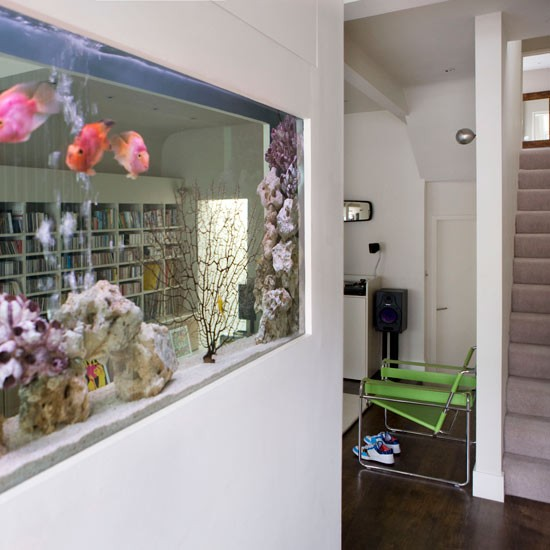 Built in large fish tank room dividers 10 inspiring for Fish tank built into wall