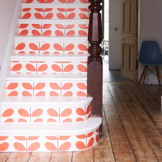 Hallway with Orla Kiely wallpaper on stair riser
