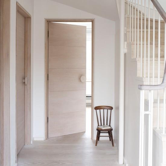Minimalist hallway | White hallway | Wooden doors | Image | Housetohome