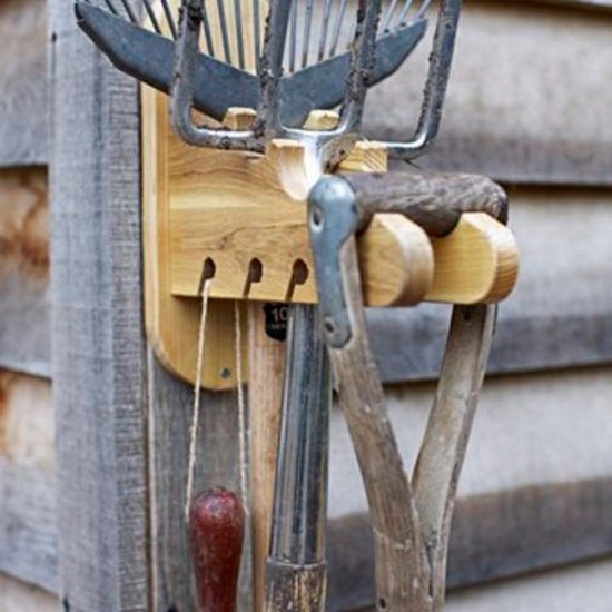 Garden tool hanger from cox cox garden storage buys for Garden tool storage ideas