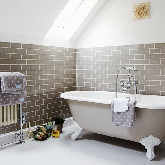 ceramic tiles on walls in bathroom with freestanding bath and radiator