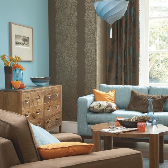 Bold blue and orange living room decorating with for Orange and brown living room ideas