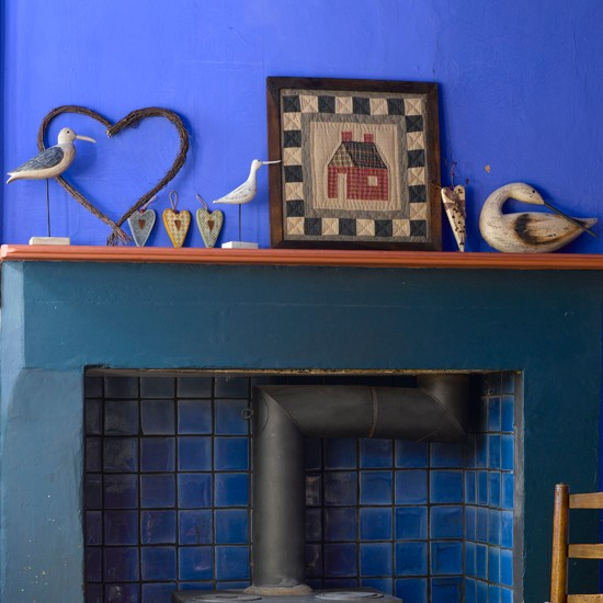 Display folk art pieces | Cosy fireplace ideas - 10 of the best | How to create a cosy fireplace | Fireplace design