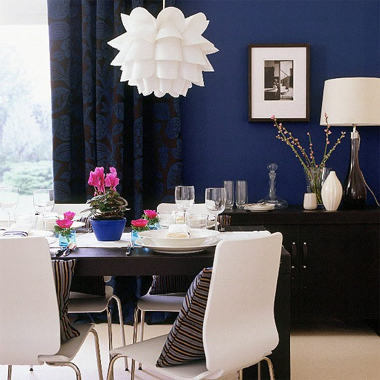 Blue modern dining room design with a combination of white furniture