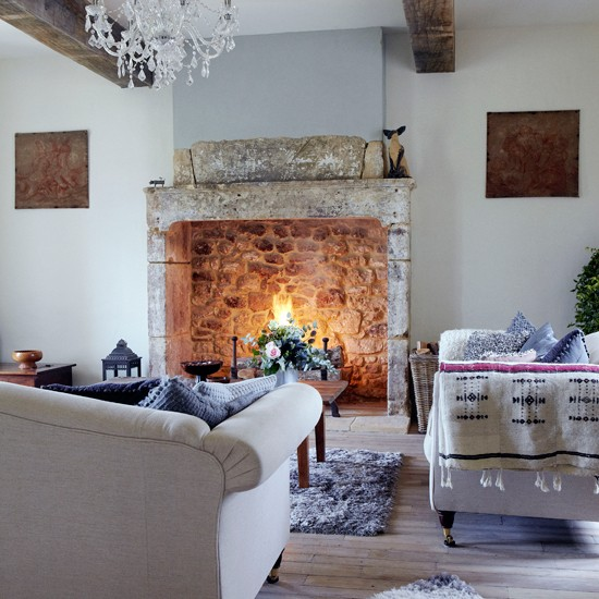 Country living room with open fire | Living room design | Fireplace | Image | Housetohome