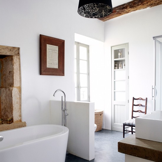 Wall Creates A Subtle Divide In This Bathroom Allowing The Bath