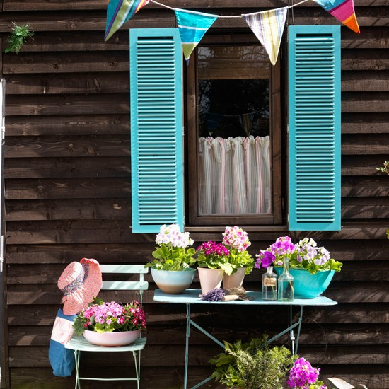 Bright blue shutters | colourful garden ideas | how to add colour to your garden | colour week | housetohome