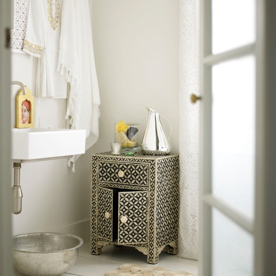 Pale bathroom with Moroccan-style cabinet | black and white bathroom | monochrome bathroom ideas | bathroom decorating inspiration | housetohome