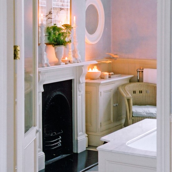 Bathroom with fireplace and cream cabinet